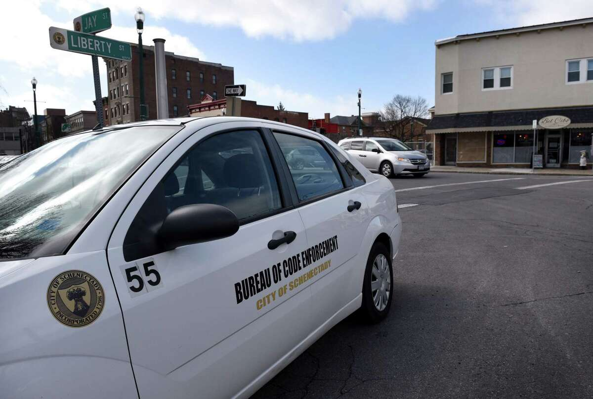 A city of Schenectady code enforcement vehicle is parked across the street from 104 Jay St. on March 2, 2017, in Schenectady, N.Y. (Will Waldron/Times Union archive)