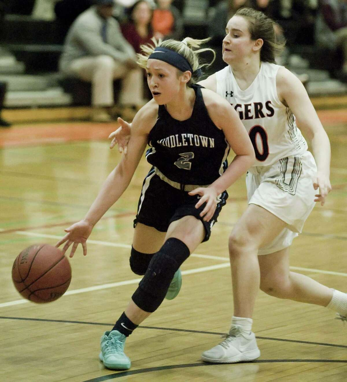 Middletown High School's Amanda Fudge works around Ridgefield High School's Kate Wagner in the Class LL girls basketball game played at Ridgefield. Monday, Feb. 26, 2018