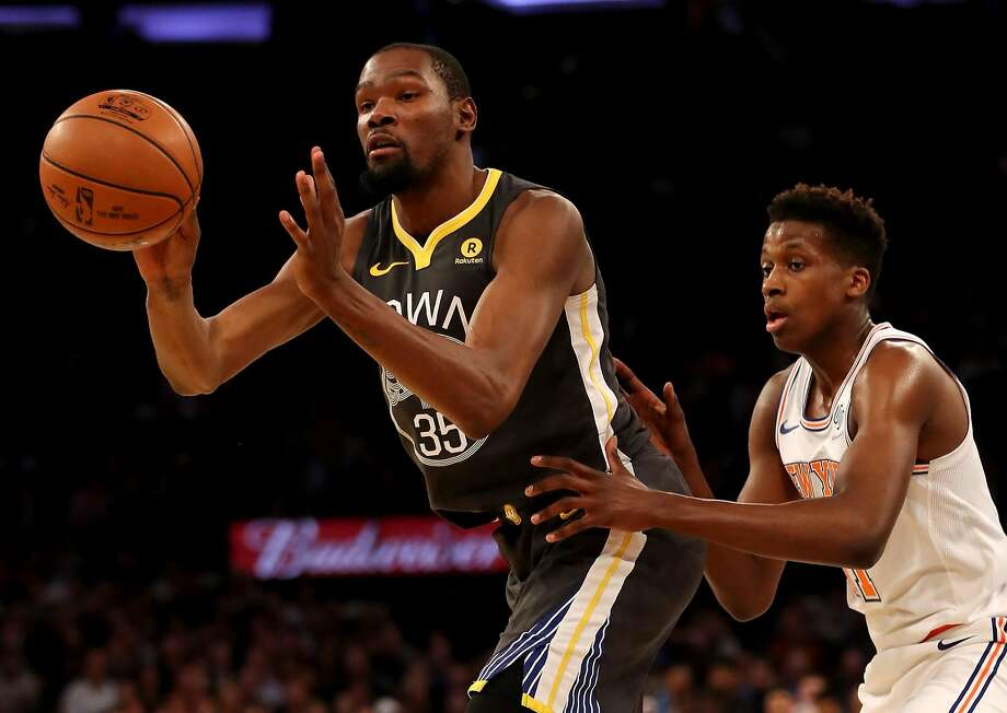 NEW YORK, NY - FEBRUARY 26:  Kevin Durant #35 of the Golden State Warriors passes as Frank Ntilikina #11 of the New York Knicks defends at Madison Square Garden on February 26, 2018 in New York City. NOTE TO USER: User expressly acknowledges and agrees that, by downloading and or using this Photograph, user is consenting to the terms and conditions of the Getty Images License Agreement  (Photo by Elsa/Getty Images) Photo: Elsa, Getty Images