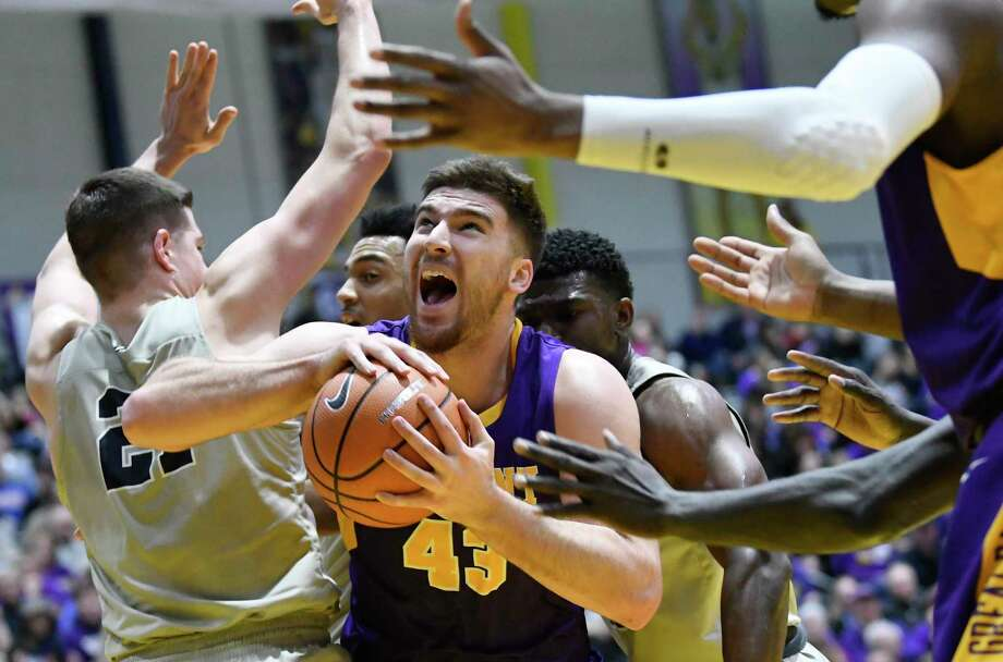 UAlbany's forward Greig Stire (43) moves the ball against New Hampshire during the first half of an NCAA men's college basketball game Saturday, Feb. 3, 2018, in Albany, N.Y. (Hans Pennink / Special to the Times Union) Photo: Hans Pennink / Hans Pennink