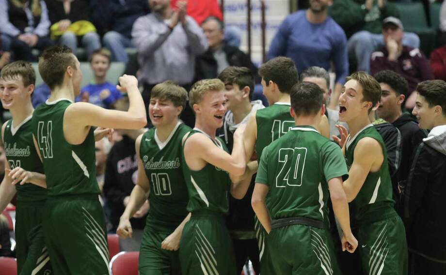Schalmont celebrates their narrow victory over Glens Falls during the Section II Class B boys' basketball semifinal at the Cool Insuring Arena in Glens Falls, NY Monday, Feb. 26, 2018. (Ed Burke-Special to The Times Union)