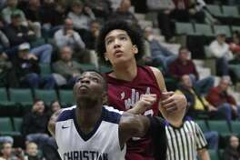 Mekeel's Gideon Agbo blocks Watervliet's Messiah Mallory for rebound position during the Section II Class B boys' basketball semifinal at the Cool Insuring Arena in Glens Falls, NY Monday, Feb. 26, 2018. (Ed Burke-Special to The Times Union)