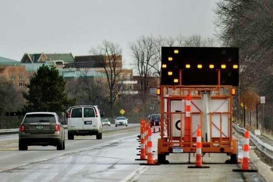 FILE: Vehicles drive across the M-20 bridge. (Katy Kildee/kkildee@mdn.net)