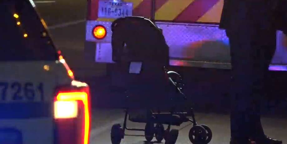 An infant in a stroller was hit by a car going through a downtown intersection, Feb. 27, 2018. Photo: Metro Video