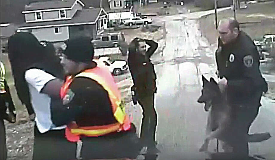 In a November 2014 dash-cam video, Alton Police Officer Pfc. Brian Brenner trains his canine, Kenzo, behind suspect Cedric Phillips. Moments earlier, the dog but Phillips on the head as he was restrained, on the ground, by officers. An investigation concluded that the officer was not properly handling the dog.