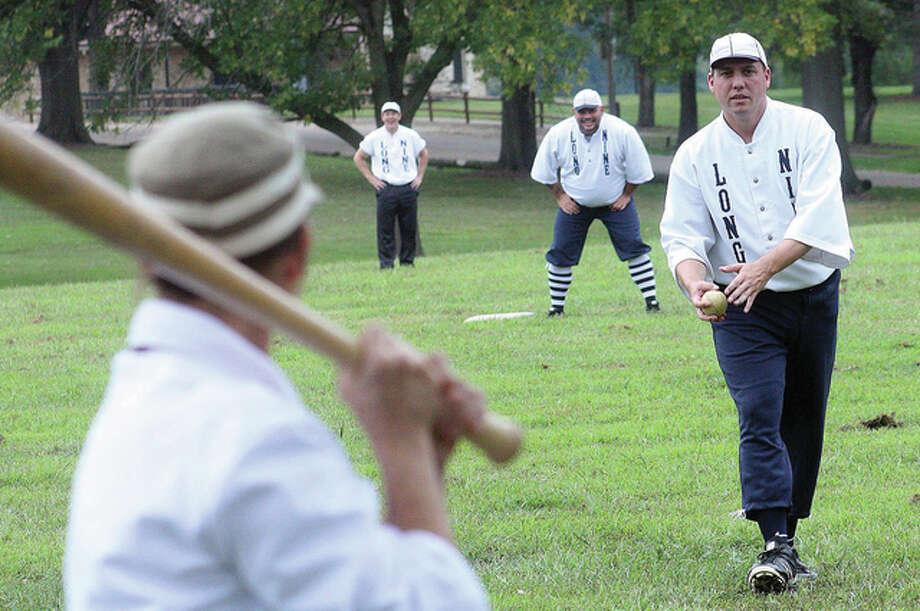 "Todd ""Pig"" Daniels of the Springfield Long Nine vintage baseball club hurls a pitch to St. Louis Brown Stockings striker Tracy ""Nightingale"" Lamothe during a match earlier this year. Both teams will face off again Sunday, Oct. 18, at Rock Spring Park in Alton."