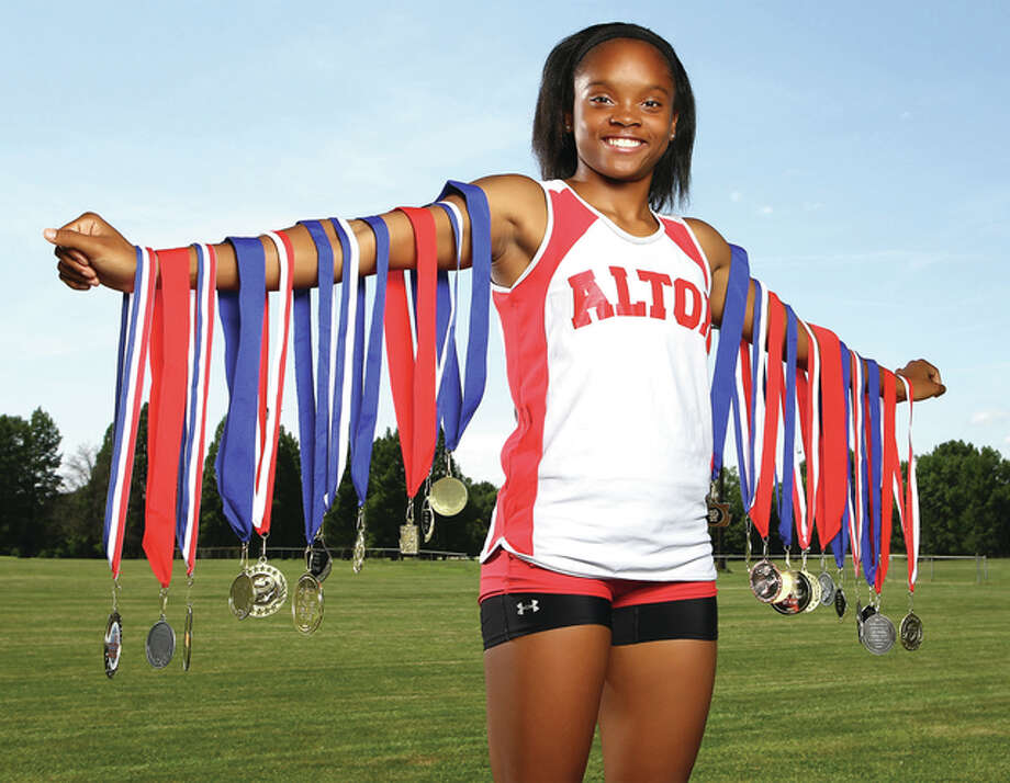 Alton's LaJarvia Brown is the 2015 Telegraph Girls Track Athlete of the Year after defending her Class 3A state championship in the triple jump. Brown is spending her summer competing against the nation's -- and world's -- best prep jumpers.Billy Hurst | For The Telegraph