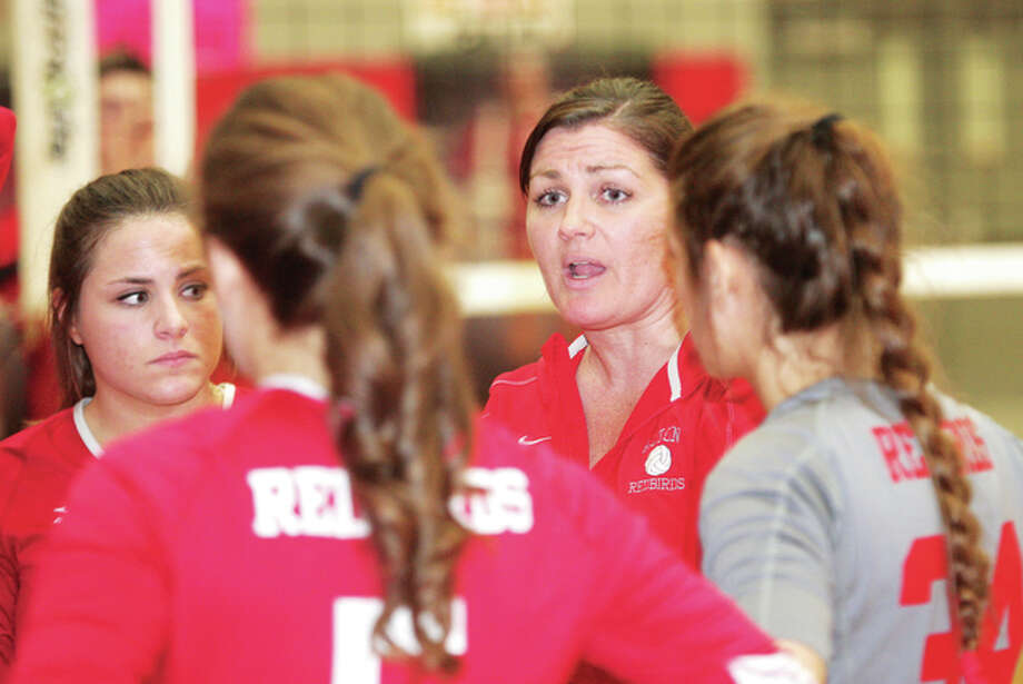 Alton coach Stacey Ferguson (middle) talks with her team during a Southwestern Conference match against Belleville West on Oct. 23 at Alton High in Godfrey. Ferguson guided the Redbirds to a 25-8-1 record — breaking the school record for wins in a season — to earn 2014 Telegraph Large-Schools Volleyball Coach of the Year honors. James B. Ritter | For The Telegraph