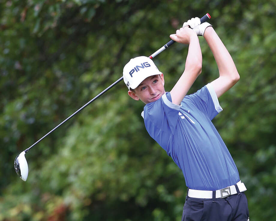 Marquette Catholic freshman Kolten Bauer, shown watching his drive during the Marquette Class 2A Regional last Tuesday at Rolling Hills in Godfrey. Bauer shot a 79 in the regional to help the Explorers to the title and a berth in Tuesday's West Frankfort Sectional at Franklin County Country Club. Billy Hurst / For The Telegraph