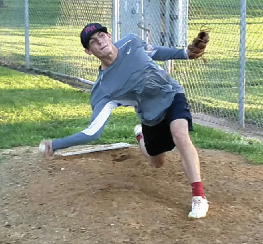 Metro East's Devin Colley pitches during a bullpen session at the legion team's workout Monday night at Hoppe Park in Edwardsville. The Bears open play in the Great Lakes Regional on Wednesday night at SIUE. Louie Korac / For The Telegraph