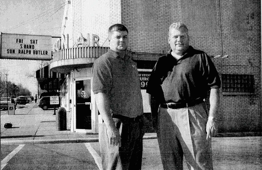 In this Nov. 28, 1999 Telegraph file photo, Eddie Sholar Jr. is pictured with Eddie Sholar Sr. outside of Fast Eddie's Bon-Air on Broadway in Alton. Telegraph file photo