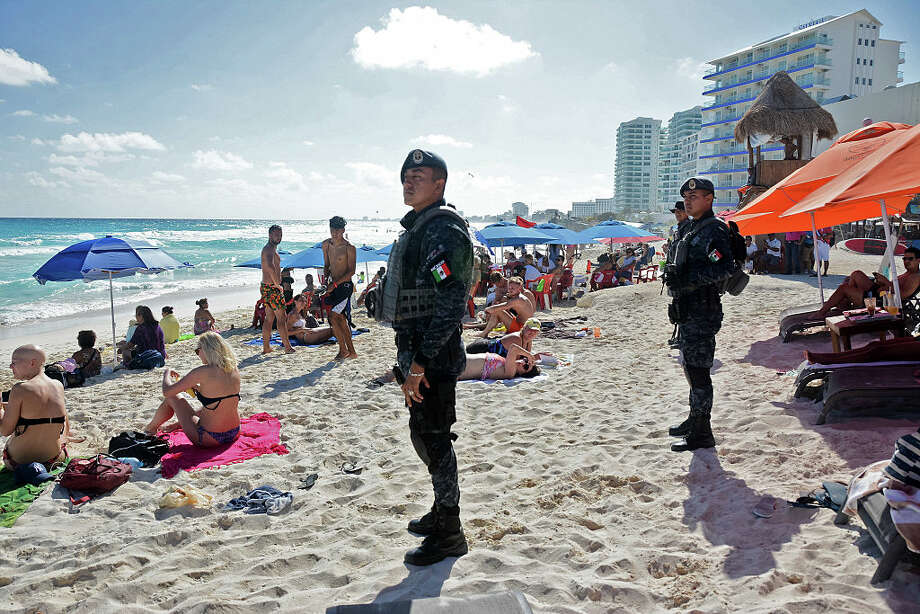 The Mexican federal police patrol a beach in Cancun, Mexico on January 18, 2017. Fourteen people were killed in Cancun in two days this month, according to reports. Photo: STR/AFP/Getty Images