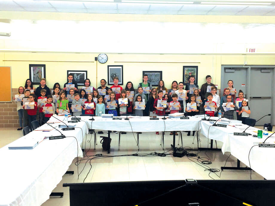 Edwardsville District 7 School's County and State Young Authors winners were honored Monday night during the Edwardsville District 7 Board of Education meeting.  2017-18 winners included Trey Dicks (state), Allyson Lunsford, Cole Reinking, Ryne Montgomery, Katherine Poe, Rachel Mueller, Delaney Philipps, Patrick Rawson and Laine Chapman from Liberty Middle School; Sophia Holobaugh (state), Annisyn Krebs-Carr, Jonathan Stump, Grace Ramsey, Akira Malik, Rachel Piazza and Tyler Chrenka from Lincoln Middle School; Taylor Smith (state), Laila Venzon, Kole Kanallakan, Jack Rigoni and Sydney Powell from Cassens Elementary; Melanie Whitsell (state), Margaret Stacy and Emma Birkenmeyer from Columbus Elementary; Keaton Bollinger (state), Kaan Demirer, Merissa Quart-Ackad and Avery Bollinger from Woodland Elementary; Taylor Steele (state), Maggie Young and Emeree Cilos from Worden Elementary; Nora Walton (state), Teagan Graville, Lux Eales and Philip Weiss from Glen Carbon Elementary; Ava Slater (state), Peter Fusaro and Evan Ousley from Goshen Elementary; Jessica Sever (state) and Sydney Baugh from Hamel Elementary; Braxton Tite (state), Maylea Dodd and Sean Terry from Leclaire Elementary; Trenton Liedtke (state) and Zoey Greenwood from Midway Elementary; and Aven Vassilakis (state), Alyssa Sayuk and Liam Catlin from Nelson Elementary. Photo: Julia Biggs • Jbiggs.edwi@gmail.com