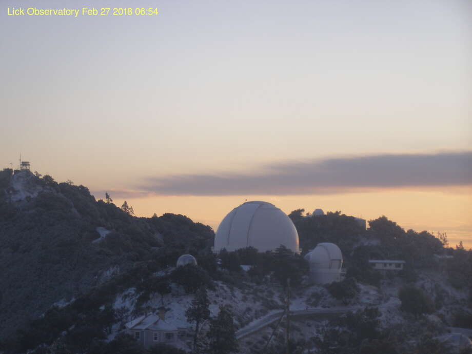 This file photo shows snow covering Mount Hamilton (elevation 4,265') and Copernicus Peak (4360') in the Diablo Range east of San Jose, Calif., on Feb. 27, 2018. A dusting is expected to hit this same peak overnight Saturday. Photo: Lick Observatory