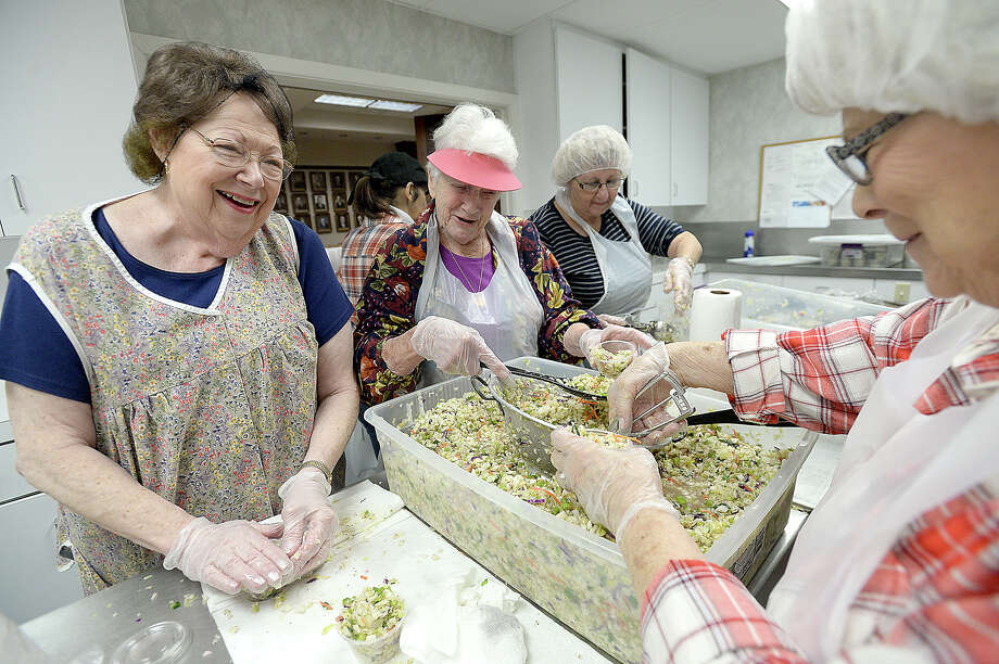 From left, Lois Rutman, Karla Blum, Rita Davis and Fern Roos mix a healthy dose of humor with their work as they help prepare for this week's annual Deli Days event at Temple Emanuel in Beaumont. Now in its 30th year, organizers say they will serve up over 1500 lunches consisting of a corned beef or turkey sandwich, homemade cole slaw, a pickle and chips, as well as 75 luncheon trays and 170 cheesecakes. Deliveries begin Wednesday, and the temple opens its doors for pre-ordered bagged lunches and walk-ins on Thursday from 11 - 1 p.m. In all, volunteers have prepped 2500 cups of coleslaw, bagged 2500 pickles, and 2500 bags of potato chips for this year's service. Leftovers will be donated to Some Other Place. Photo taken Monday, February 26, 2018 Kim Brent/The Enterprise Photo: Kim Brent / BEN