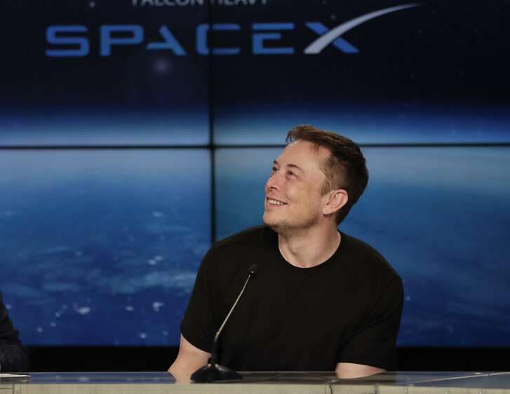 FILE- In this Feb. 6, 2018, file photo, Elon Musk, founder, CEO, and lead designer of SpaceX, speaks at a news conference after the Falcon 9 SpaceX heavy rocket launched successfully from the Kennedy Space Center in Cape Canaveral, Fla. South Africa-born Elon Musk created electric car maker Tesla. A study last year by the Center for American Entrepreneurship concluded that 43 percent of the companies in the Fortune 500 were founded by first- or second-generation immigrants. (AP Photo/John Raoux, File)