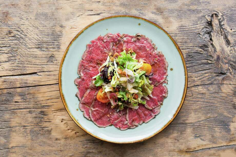Spicy beef carpaccio made with 44 Farms Prime beef tenderloin, farm greens and sweet chili and agave dressing. Photo: Julie Soefer / Julie Soefer Photography
