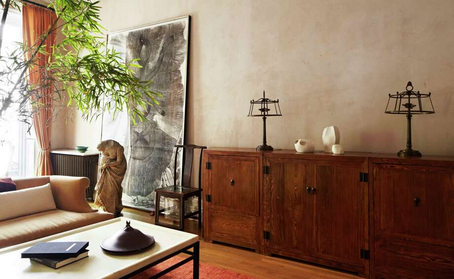 This five-story brownstone in New York's Brooklyn Heights has a piece of art that's a remnant of decorative arts in the building sometime in the home's previous life. Photo: William Abranowicz