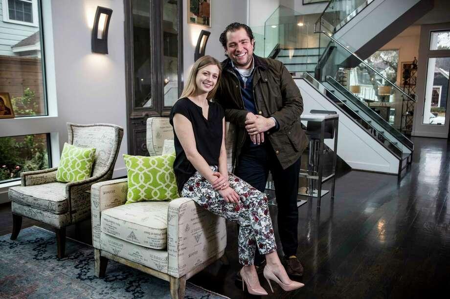 Tatiana Galitzine Sierra and her husband, Guillermo Sierra, pose for a portrait in their living room on Thursday, Jan. 18, 2018, in Houston. ( Brett Coomer / Houston Chronicle ) Photo: Brett Coomer, Staff / © 2018 Houston Chronicle