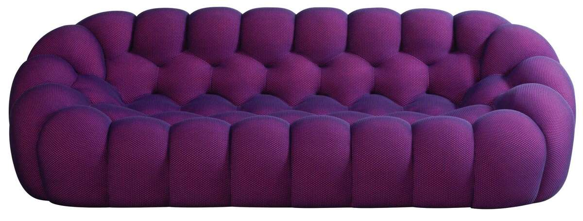 """Sacha Lakic's popular Bubble line for Roche Bobois continues to grow with his new curved three-four seat sofa and a grand pouf. And, in its """"malva"""" shade, they join the growing purple crowd.$3,565 grand pouf; Roche Bobois, 4810 San Felipe"""