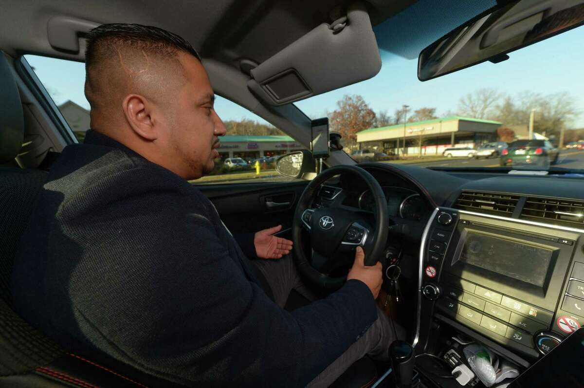Uber driver, Carlos Ortiz, in his car in Norwalk.