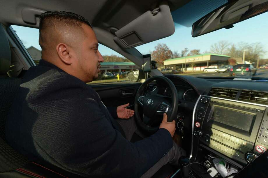 Uber driver, Carlos Ortiz, in his car in Norwalk. Photo: Erik Trautmann / Hearst Connecticut Media / Norwalk Hour