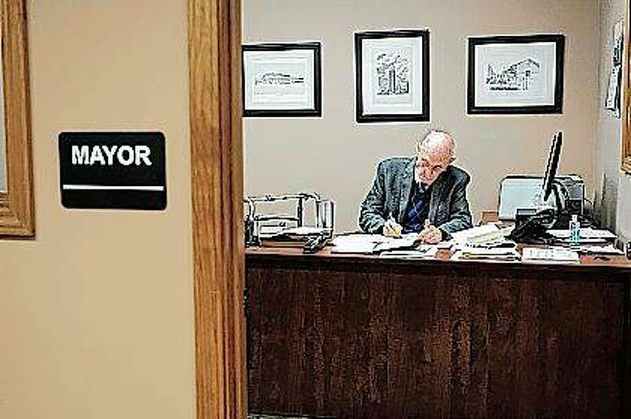 Marion Mayor Bob Butler works Tuesday in his office in Marion. Wednesday was Butler's final day after 55 years as mayor. He took office in 1963 and has been elected by three generations of voters Photo: Byron Hetzler | The Southern Illinoisan (AP)