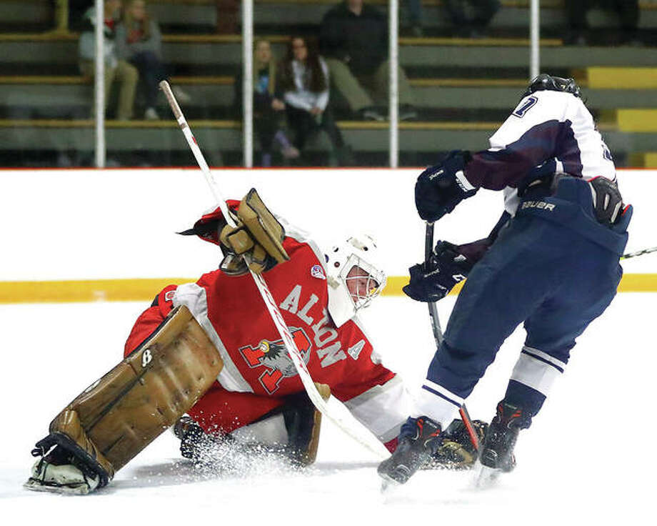 Alton goalie Caleb Currie made 17 saves in his team's 3-1 victory over rival Bethalto in the first round of the Mississippi Valley Club Hockey Association playoffs at the east Alton Ice Arena. Currie is shown in earlier action against Belleville. Photo: Telegraph File Photo