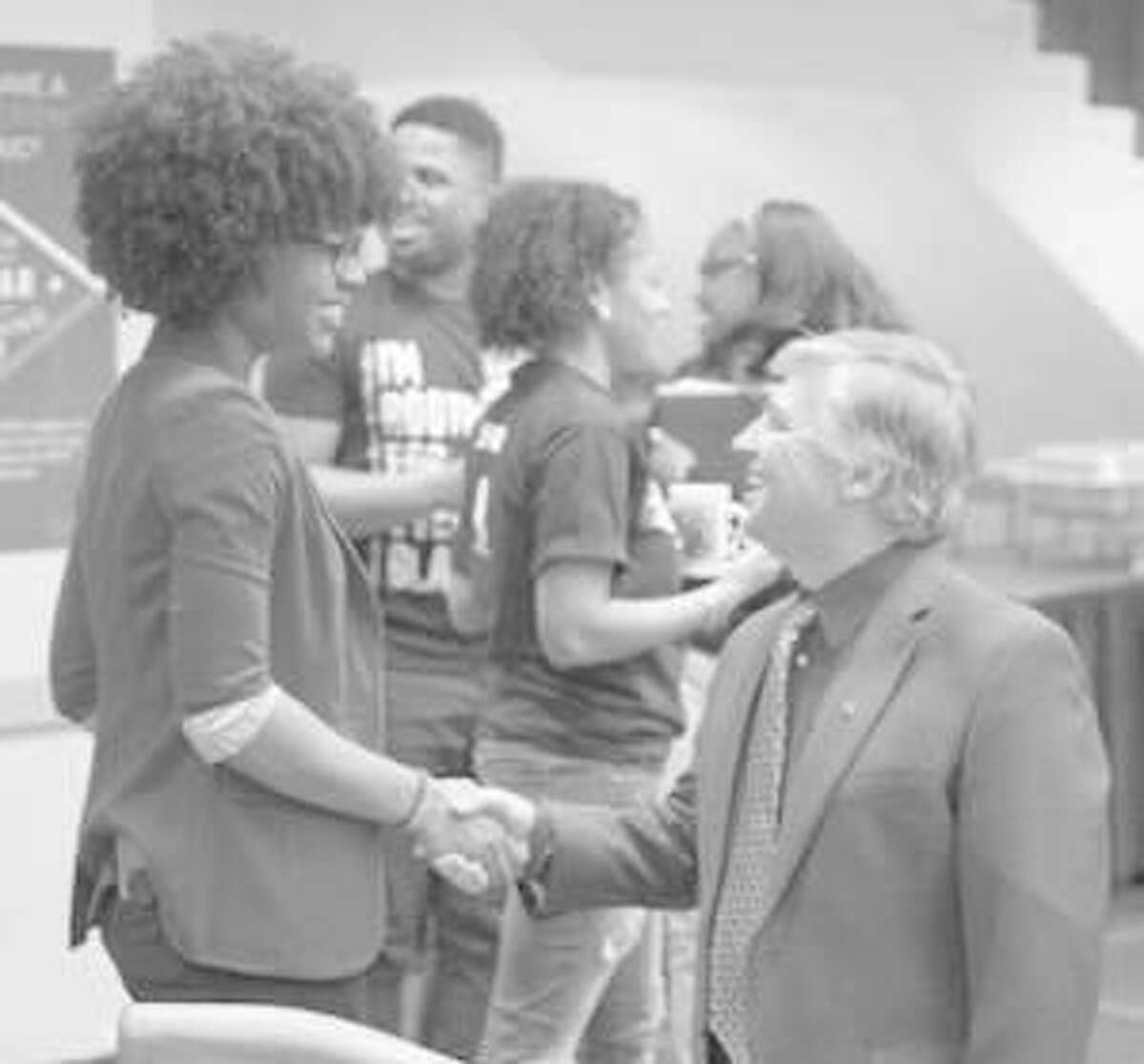 Marissa Williams, SIUE Black Heritage Month chair, welcomes SIUE Chancellor Randy Pembrook to the SIUE Black Heritage Month Opening Ceremony.