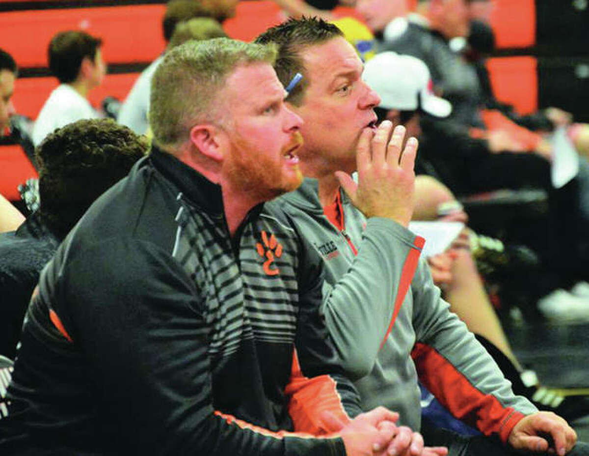 Edwardsville coach Jon Wagner (right) and assistant Doug Heinz watch the heavyweight match during a SWC dual with Alton earlier this season in Edwardsville. The Tigers won their seventh straight Class 3A regional championship Saturday at Quincy.