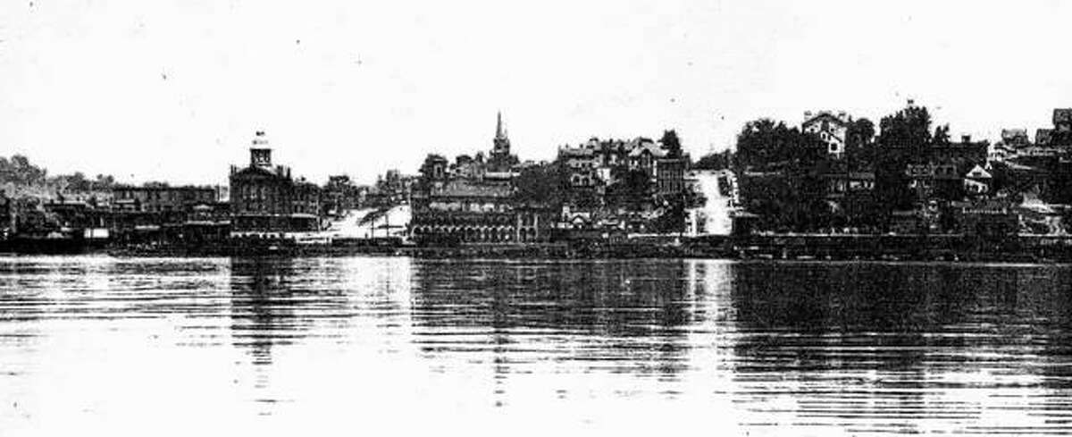In about 1916, photographer W.H. Wiseman photographed the Alton riverfront. The river was calm, and Wiseman was able to take enough photographs to build a splendid panoramic view of Alton from the Mississippi.