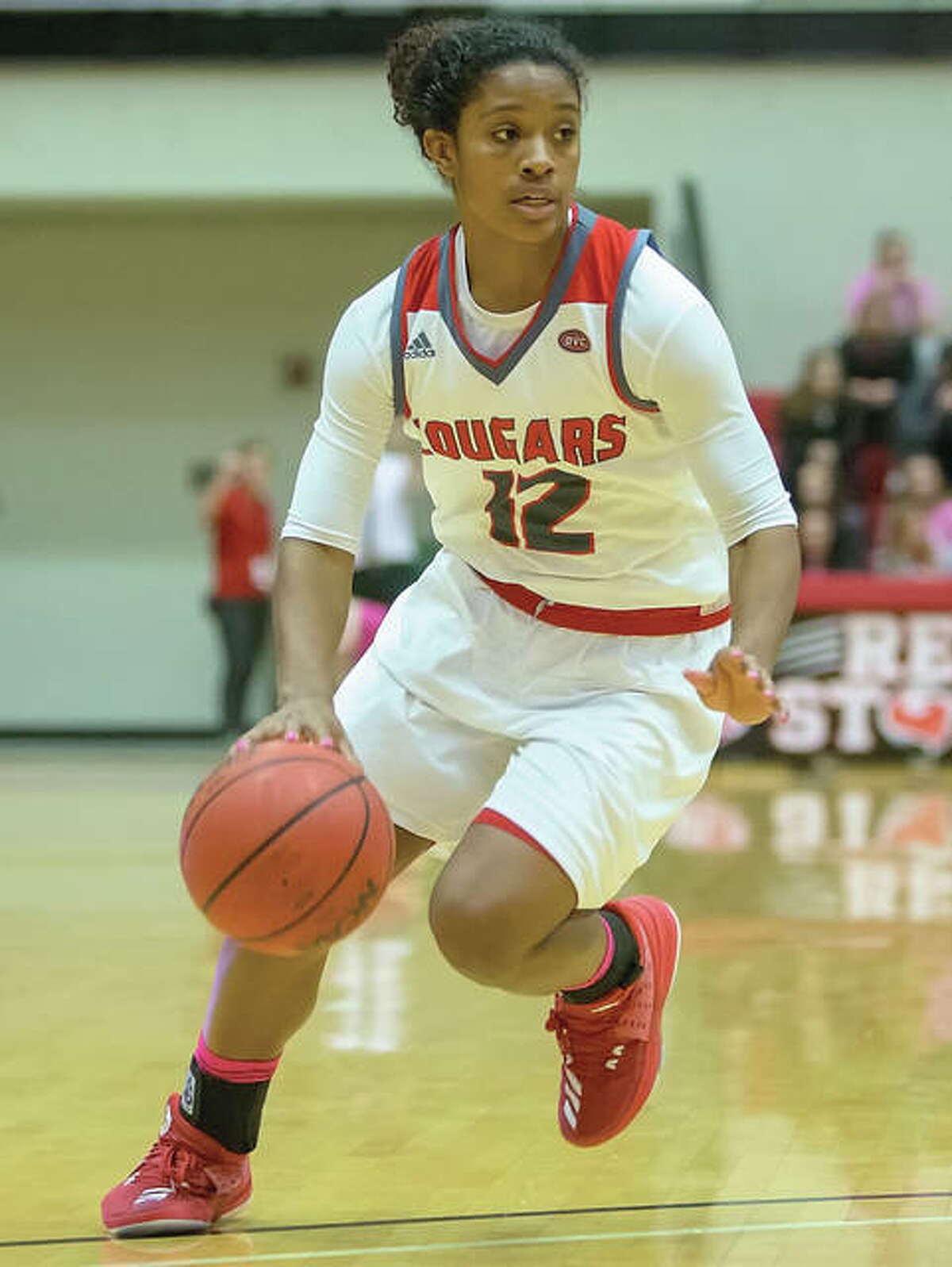 SIUE's Lauren White, a fifth-year senior from Edwardsville, and the Cougars celebrated a key OVC women's basketball victory over Jacksonville State on Saturday night at Vadalabene Center in Edwardsville.