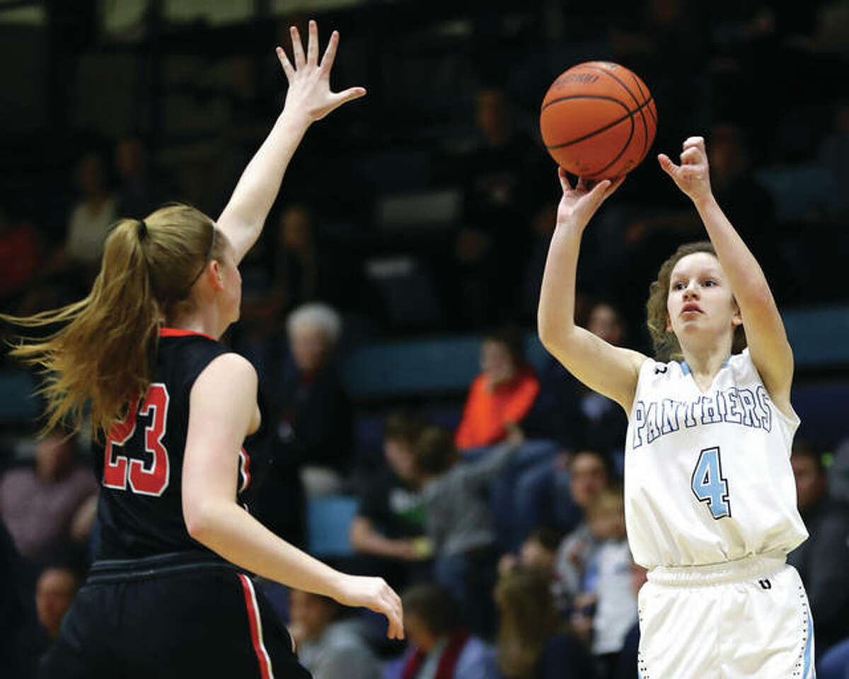 Jersey's Brianna Schroeder (right) hits a 3-pointer over Highland's Lauren Baer on Thursday night during the Panthers' Mississippi Valley Conference double-overtime victory at Havens Gym in Jerseyville. Schroeder was one of two Jersey seniors honored Saturday on Senior Day at Jersey before their team's win over Columbia.