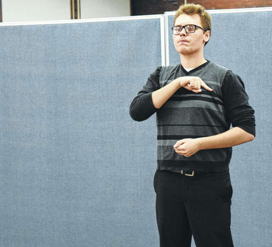 "Michael Lapa, 18, of Palos Heights delivers a monologue from Thomas Paine's ""Common Sense"" at the Illinois School for the Deaf. Photo: Maria Wittenauer 