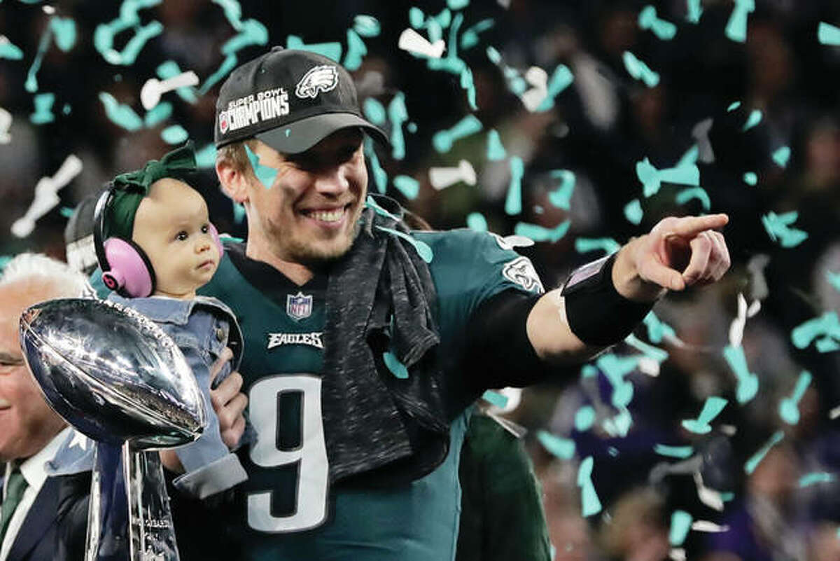 Eagles QB Nick Foles holds his daughter, Lily James, after winning Super Bowl 52 and MVP honors with a 41-33 victory over the New England Patriots on Sunday in Minneapolis.