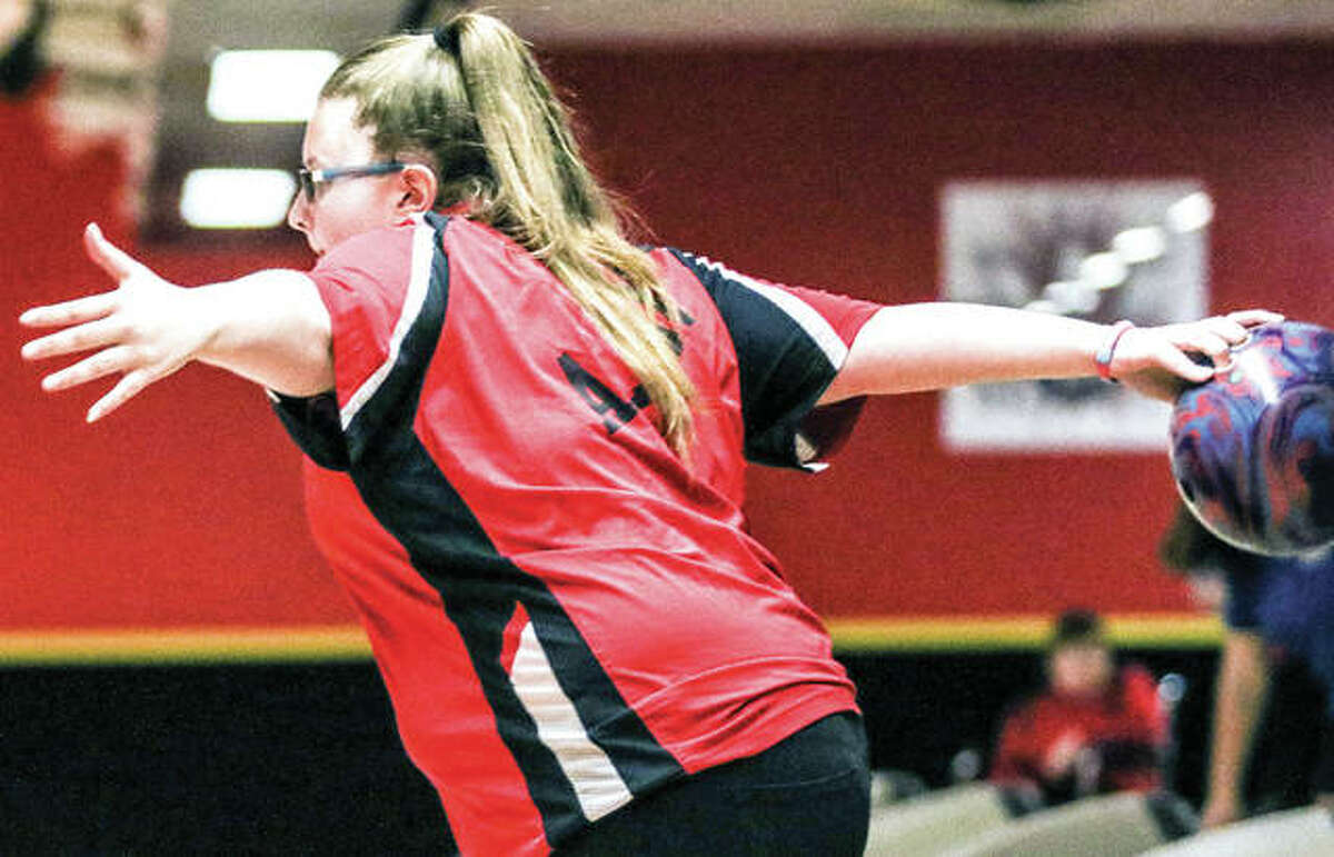 Alton High's Alex Bergin focuses on her delivery during the IHSA Girls Bowling Regional Tournament last weekend at Bowl Haven. Bergin won the individual regional championship and will lead her team to the Mount Vernon Sectional this Saturday.