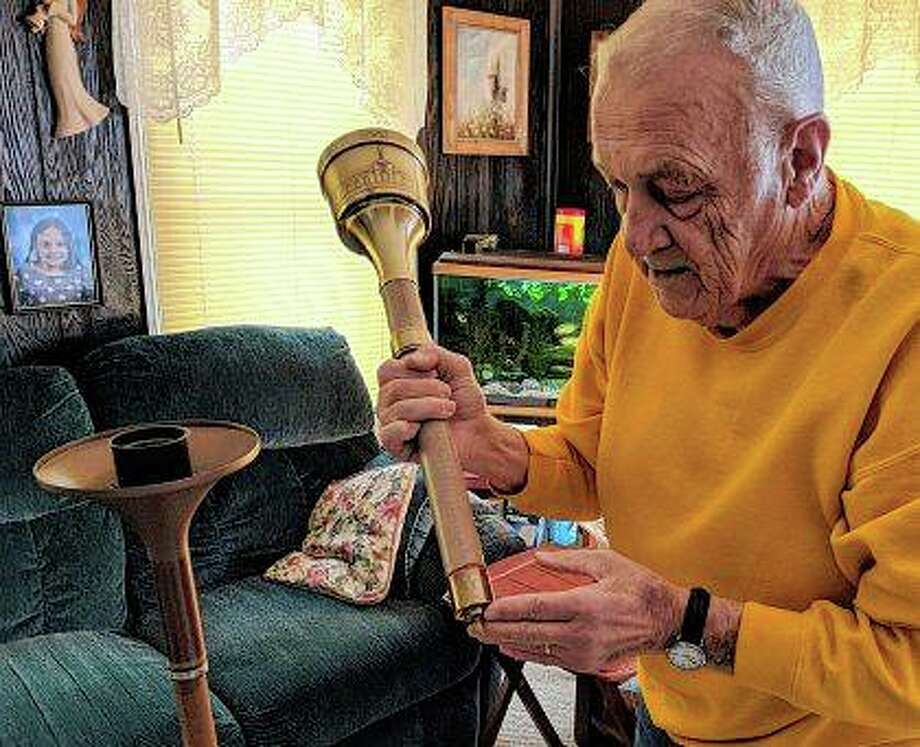 Jerry Pelan of Sycamore demonstrates how the torch used for the 1984 Los Angeles Olympics worked. Pelan was superintendent of the Turner Brass Plant where the torches were designed and made. Kevin Solari | Daily Chronicle (AP)
