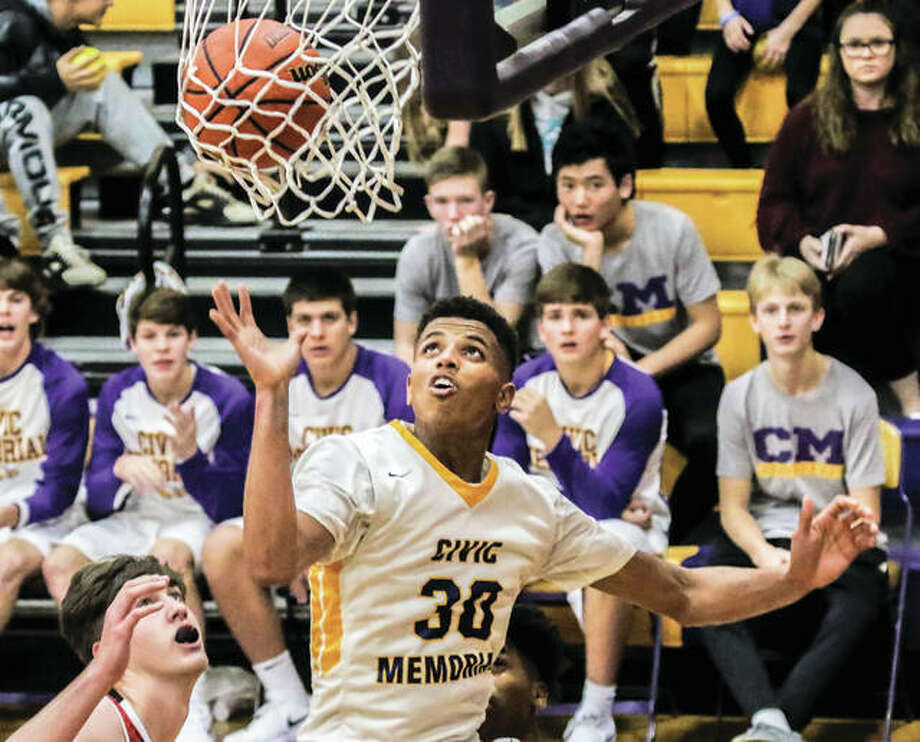 Civic Memorial's Jaquan Adams (30), shown scoring during a game against Granite City on Nov. 22 in Bethalto, scored a career-high 33 points Tuesday night to lead the Eagles to a MVC victory over Mascoutah in Bethalto. Photo: Nathan Woodside / For The Telegraph