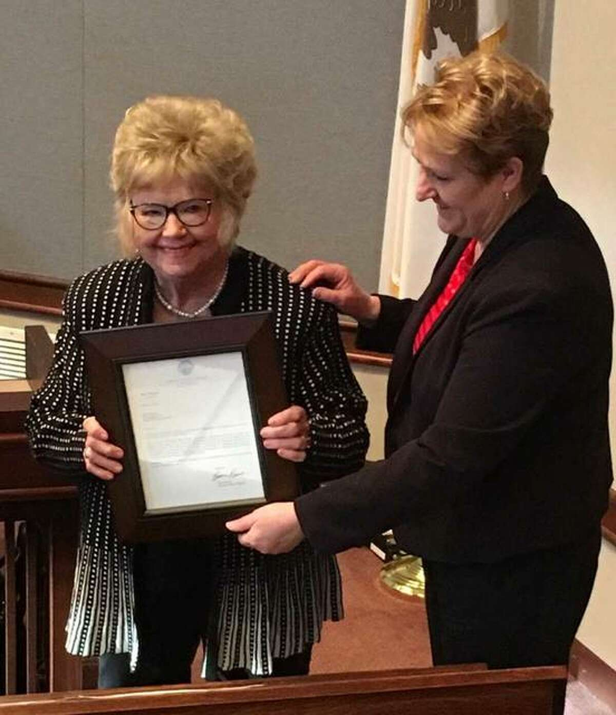 Director of the Illinois Department of Aging Jean Bohnhoff presents Madison County Board member Helen Hawkins, of Granite City, with a letter of recognition by Governor Bruce Rauner Wednesday for her induction into the Illinois Senior Hall of Fame.