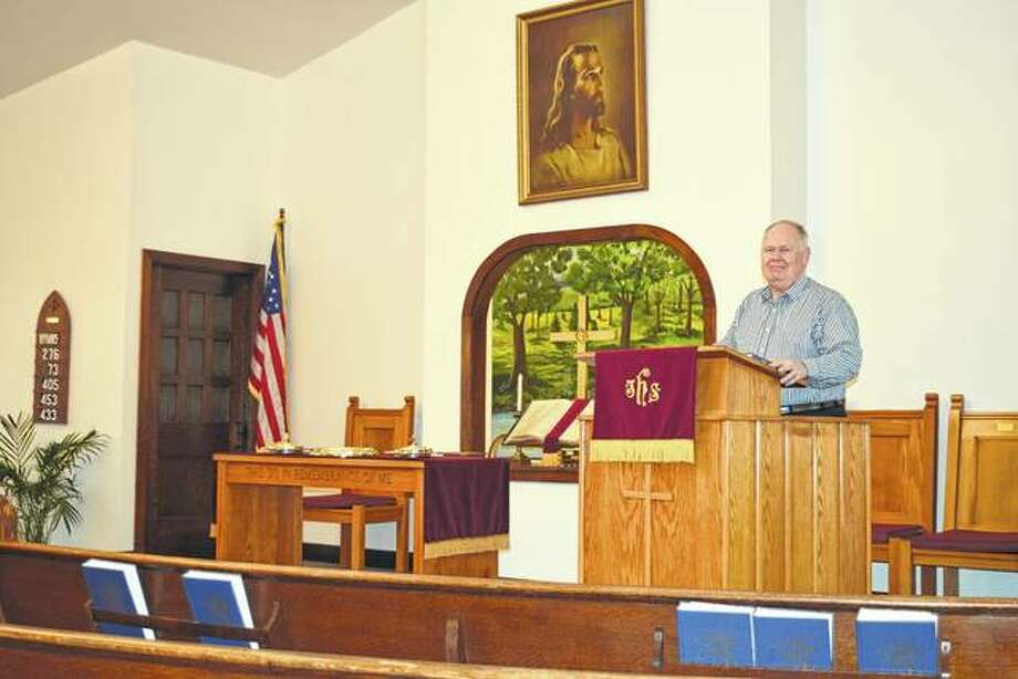 Lynnville Christian Church Pastor Frank Hungerford stands at the podium of the new church, which will be dedicated Feb. 18.