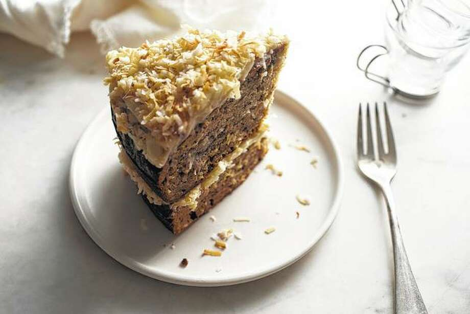 A wedge of banana-coconut layer cake features roasted bananas and the use of coconut in both the cake and the frosting. Photo: Andrew Scrivani | The New York Times