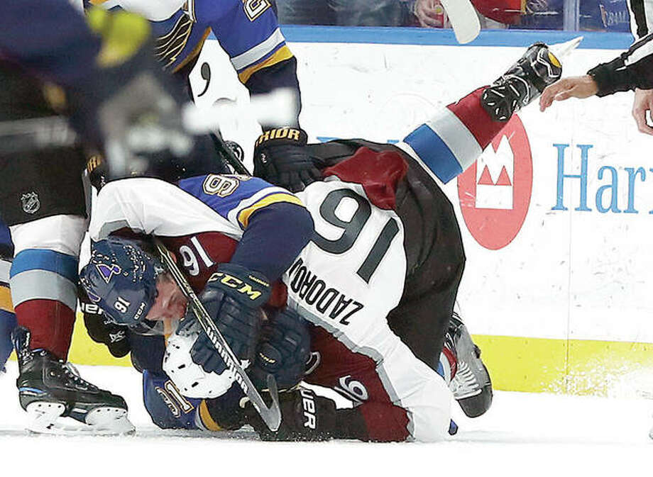 The Blues' Vladimir Tarasenko (91) and Colorado's Nikita Zadorov (16) fight during the first period Thursday night's game in St. Louis. Photo: Jeff Roberson | AP Photo