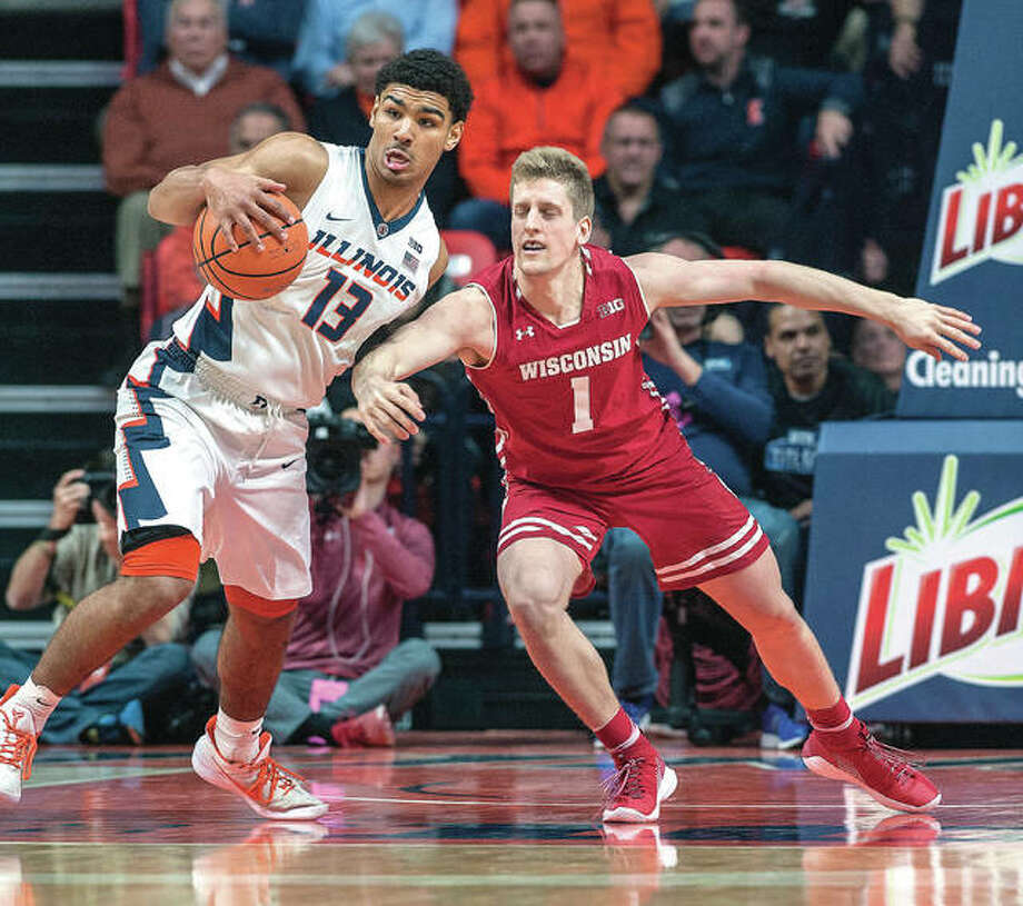 Illinois guard Mark Smith (13), a freshmn from Edwardsville, grabs the ball away from Wisconsin guard Brevin Pritzl Thursday night's game in Champaign. Photo: AP