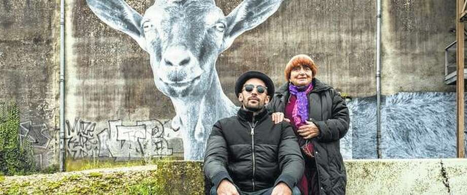 "French street artist J.R. (left) and French documentary director Agnes Varda pause for a moment in front of one of J.R.'s works while filming their Oscar-nominated ""Faces Places"". Photo: Handout Photo"