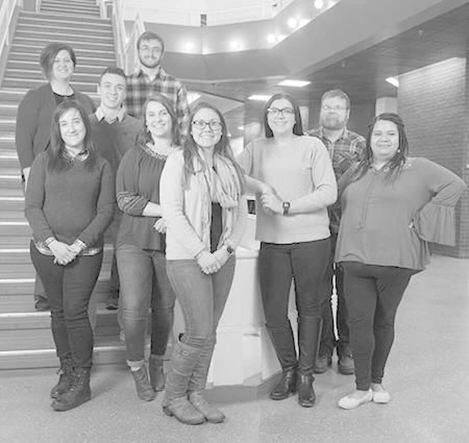 SIUE's Dr. Sarah Conoyer (far left) stands with student researchers, from left, Shelbi Simmons, Brenden Shelton, Tyler Simpson, Jennifer Robbins, DeAnna Scully, Nicole Ties, Bradley Peradotto and Gabrielle Ellis. Photo: For The Telegraph