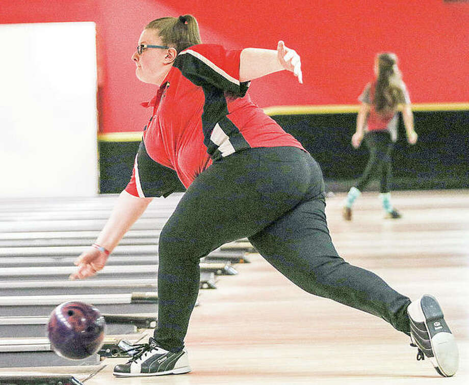 Alton junior Alex Bergin send the ball down the lane at last week's Alton Girls Bowling Regional. She was the individual champion with 1,246 pins. She and her teammates captured the fourth spot in the team standings, qualifying the Redbirds for Saturday's Mount Vernon sectional Tournament. Photo: Nathan Woodside | For The Telegraph