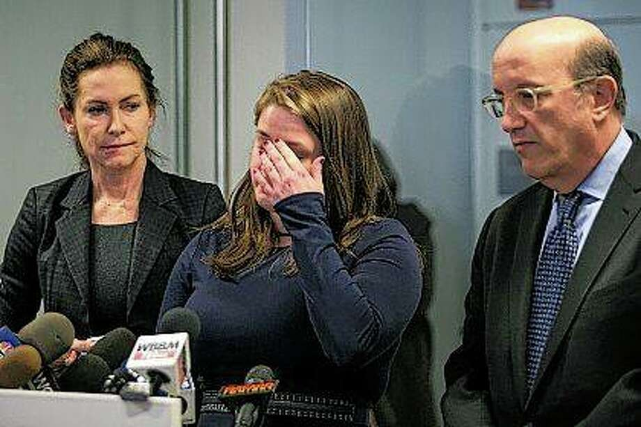 Alaina Hampton, a campaign worker for Illinois Democrats, speaks during a news conference Tuesday, accompanied by advocates Lorna Brett (left) and Shelly Kulwin. Hampton addressed reporters a day after House Speaker Michael Madigan dismissed political consultant Kevin Quinn after an investigation found Quinn sent her inappropriate text messages. Hampton asked Kevin Quinn several times to stop asking her out and sending suggestive texts, which started in 2016. She reported the behavior in February 2017 to Quinn's supervisor. In November, she wrote to Madigan, who had an attorney investigate. Photo: Ashlee Rezin | Chicago Sun-Times | AP
