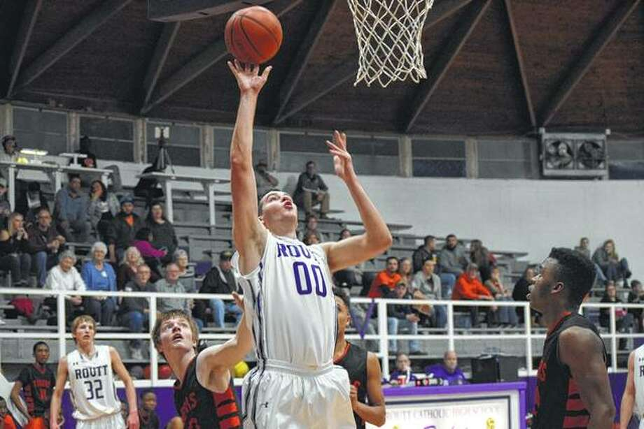 Brooks Moore (00) makes a shot from under the basket Friday night at Routt's senior night.