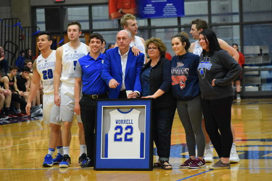 Retiring coach Mike Worrell receives a parting gift from the Illinois College athletics department .