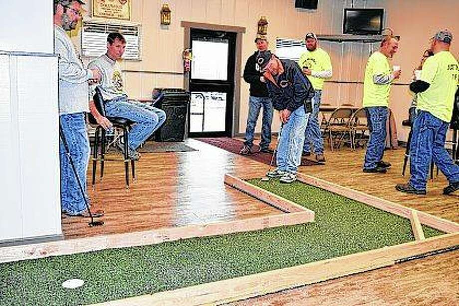 Joe Hayes of Jacksonville putts in the 17th annual Bar-2-Bar Golf Classic Saturday at the Knights of Columbus Hall in downtown Jacksonville. Nine bars participated in the fundraising event. This year's proceeds benefit Jacksonville Main Street. Photo: Greg Olson | Journal-Courier